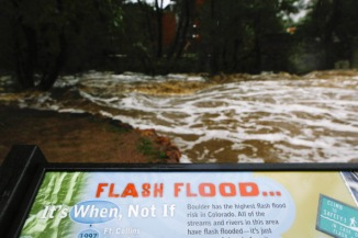 Boulder Creek swells in size after three days of heavy rainfall in September 2013. Flash flood sirens warned people to stay away from Boulder Creek and seek higher ground.  (Photo by Dana Romanoff/Getty Images)
