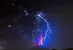 View from Frutillar, southern Chile, of lava spewing from the Calbuco volcano, on April 23, 2015. Chile's Calbuco volcano erupted on Wednesday, spewing a giant funnel of ash high into the sky near the southern port city of Puerto Montt and triggering a red alert. Authorities ordered an evacuation for a 10-kilometer (six-mile) radius around the volcano, which is the second in southern Chile to have a substantial eruption since March 3, when the Villarrica volcano emitted a brief but fiery burst of ash and lava. AFP PHOTO/MARTIN BERNETTIMARTIN BERNETTI/AFP/Getty Images