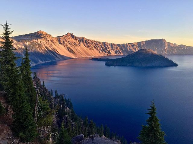 An incredible sunrise over Crater Lake. 💜The lake is surrounded by mountains and was created more than 7,700 years ago after a volcano erupted. #nps #craterlake #findyourpark #Oregon @nationalparkservice #lovegoparks @goparks @columbia1938